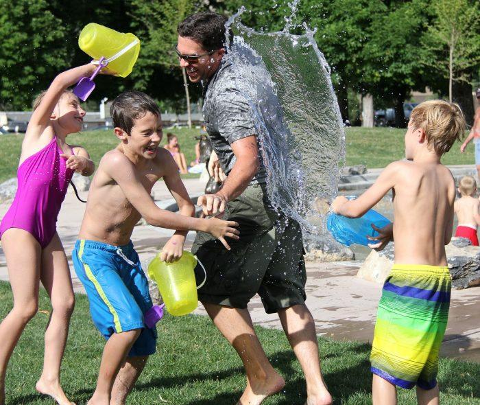Kids and a man enjoying cheap days out